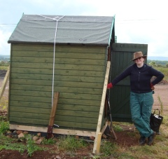 SB standing beside the allotment shed