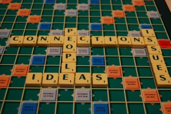 scrabble board with words relating to connections, e.g. ideas, people