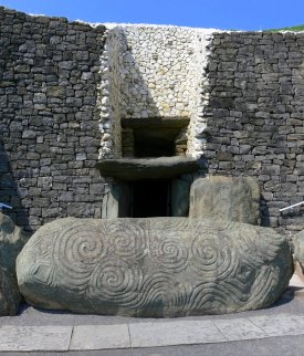 Newgrange tomb entrance passage and stone with spirals