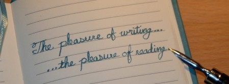 Notebook and pen with handwritten text